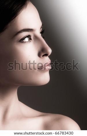natural young woman beauty portrait, profile, studio shot - stock photo