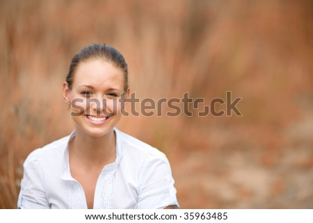 Natural young woman in the countryside - stock photo
