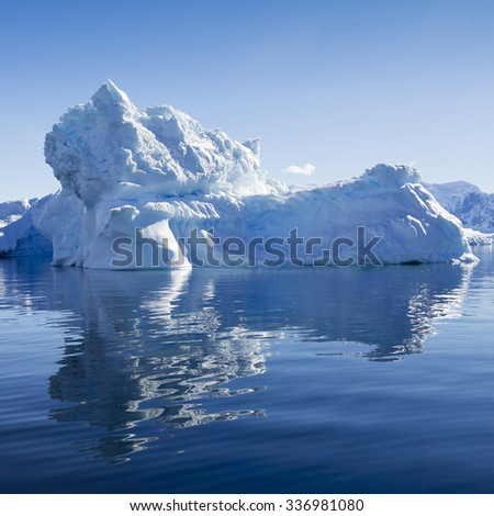 Nature and landscapes of Antarctic. Travel on the scientific vessel among ices. Studying of a phenomenon of global warming. Ices and icebergs of unusual forms and colors. - stock photo