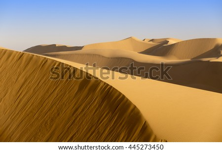 Nature and landscapes of desert. Sandy desert at sunset time.
