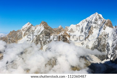 Nature and mountaineering. View on height mountains peak