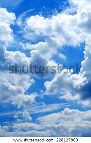 Nature background. Many white clouds in blue sky