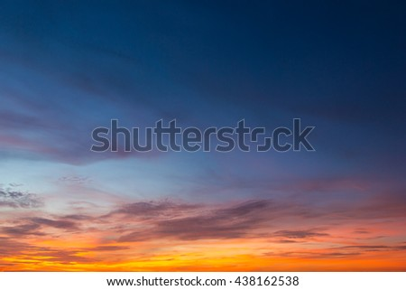 Nature background of clouds and blue sky, bright orange and yellow colors in the early morning. - stock photo