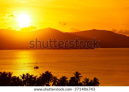 Nature Background. Scenic View Landscape Of Tropical Island Coast At Orange Sunset Over Beautiful Sea With Floating Boat And Palms Silhouette. Scenery. Travel To Thailand. Tourism. Summer Vacations