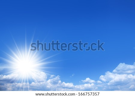 Nature background. Shining sun on the blue sky.