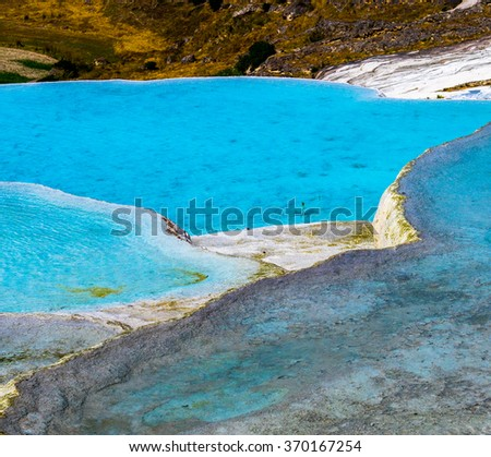 Nature background - white travertines with turquoise water. Thermal springs in resort Pamukkale - natural reserve in Turkey. - stock photo