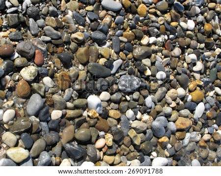 Nature background with sea wet pebble stones     - stock photo