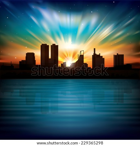 nature background with sunrise and silhouette of city - stock photo