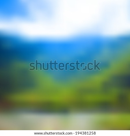 Nature blurred unfocused background. Mountains, forrest and lake. - stock photo
