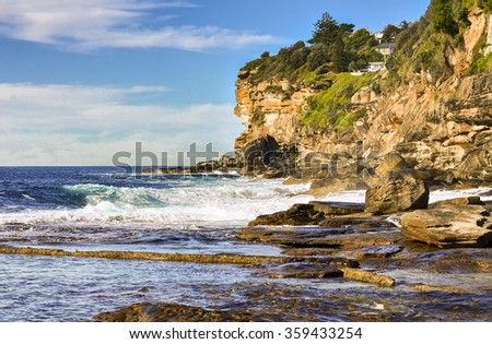 Nature, cliff, waves and winds at Dee Why Beach, Sydney, Australia during daytime. - stock photo