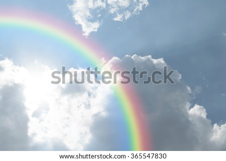 Nature cloudscape with blue sky and white cloud with rainbow - stock photo