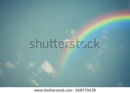Nature cloudscape with blue sky and white cloud with rainbow , process in vintage style - stock photo