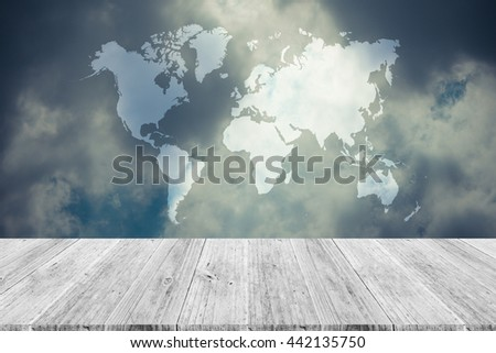Nature cloudscape with blue sky and white cloud with Wood terrace and world map , process in vintage style - stock photo