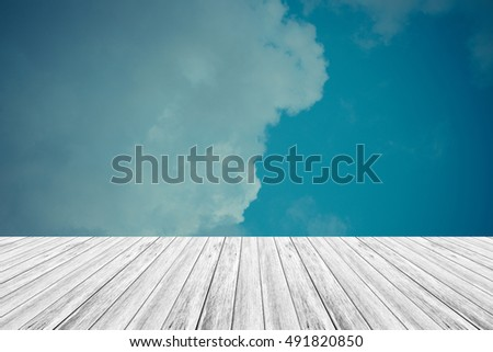 Nature cloudscape with blue sky and white cloud with Wood terrace , process in vintage style