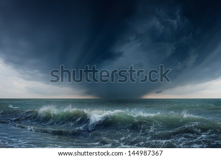 Nature force background - dark stormy sky and sea