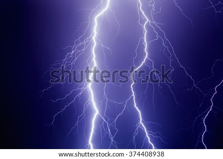 Nature force background - powerful lightnings in dark stormy sky, stormy weather - stock photo