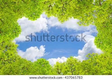 nature green leaves frame and border on blue sky and clouds with empty space
