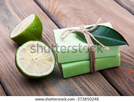 Nature Handmade soap with  lime on a old wooden background - stock photo