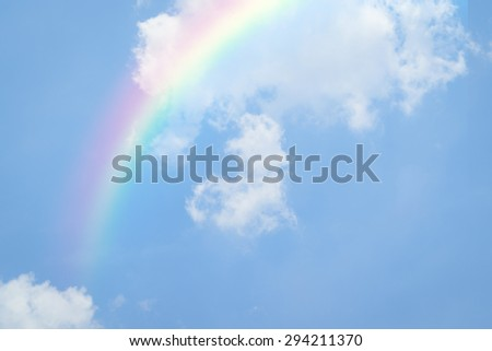 Nature heart cloudscape with blue sky and white cloud with rainbow - stock photo