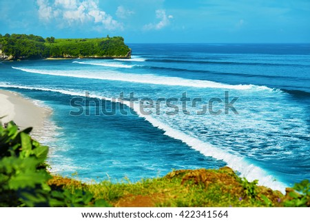 Nature Landscape Background. Scenic View Of Beautiful Paradise Island Coast With Green Cliffs, Waves On Sea And Clear Blue Sky Over Ocean Horizon. Tropical Seascape Scenery, Coastline. Summer Travel - stock photo