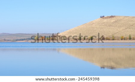 Nature landscape - lake, hills and sky - stock photo