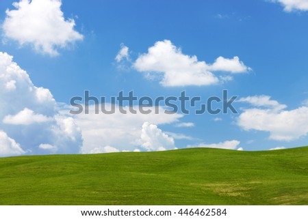 Nature landscape with sky, clouds, hills and grass
