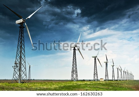 Nature landscape with wind energy generator station