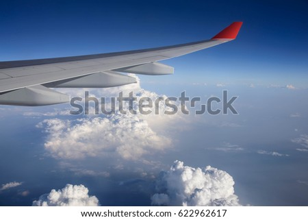 Nature lighting, Wing of airplane from window with beautiful sky.(Selective Focus)