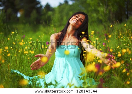 nature love woman on flower field - stock photo