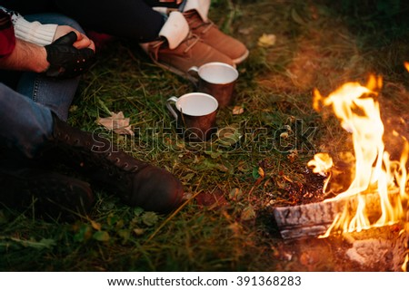 Nature lovers on sitting around the campfire at night