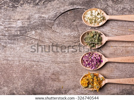 Nature medicine . Herbs in wooden spoon . - stock photo