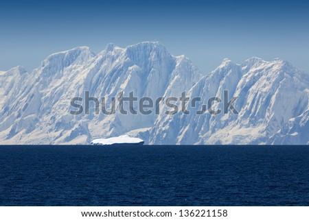 Nature of Antarctic Peninsula. Glaciers and icebergs. Travel on deep pure waters among ices of Antarctica. Fantastic snow landscapes. - stock photo