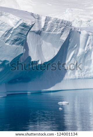 Nature of Antarctic Peninsula. Ices and icebergs. Travel on deep pure waters among glaciers of Antarctica. Fantastic snow landscapes.