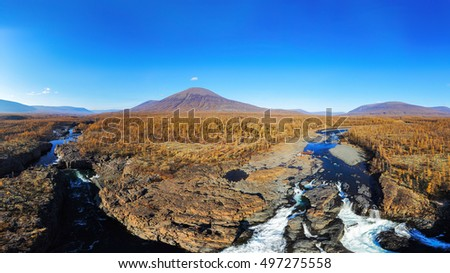 Nature panoramic Aerial view landscape of Siberian at autumn. Nature mountains, river and waterfall autumn view. Landscape mountains.