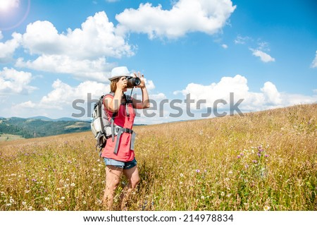 Nature photographer at work in a wheat field - stock photo