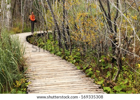 Nature photographer in Plitvice National Park, Croatia, Europe - stock photo