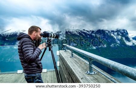 Nature photographer Stegastein Lookout Beautiful Nature Norway. - stock photo