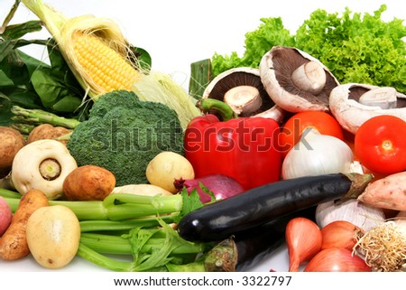 Nature's bounty - a variety of fresh vegetables.  Includes spinach, corn, asparagus, parsnip, potatoes, celery, eggplant, tomatoes, mushrooms, pumpkin, leeks, shallots, lettuce, broccoli, capsicum.