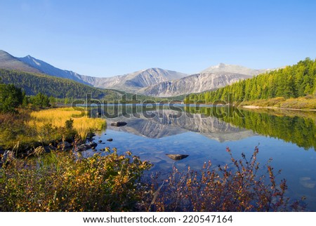 Nature scenic view of a mountain and a body of water. - stock photo