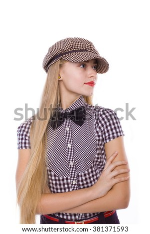 naughty blond girl in plaid cap on white background