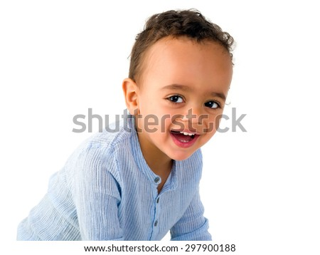 Naughty eyes of an 18 month old mixed race toddler boy - stock photo
