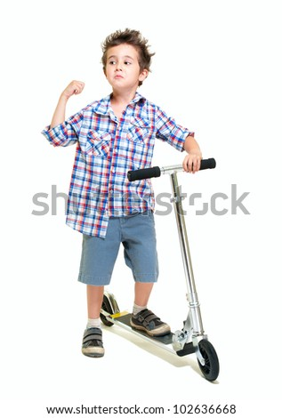 Naughty hairy little boy in shorts and shirt with scooter isolated on white - stock photo