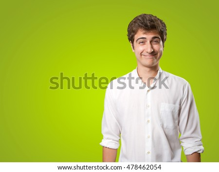Naughty young man on green background