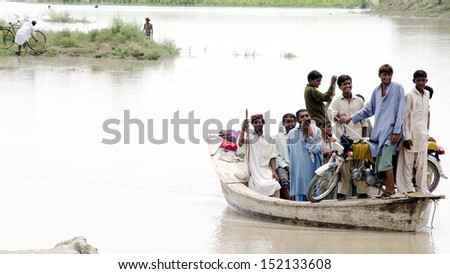 NAUNDERO, PAKISTAN - AUG 30: Views after flood in Burira village as the flood ruined  cultivations and houses in the locality of Naundero on August 30, 2013 in Naundero. - stock photo
