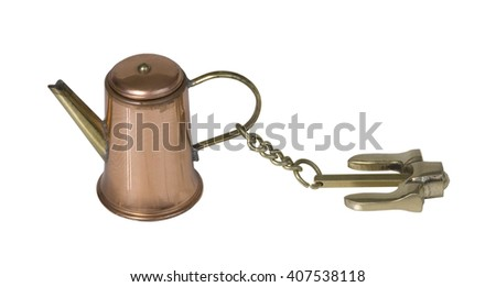 Nautical anchor used to anchor down a boat to keep from drifting on a coffee pot - path included - stock photo