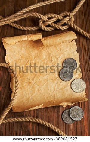 Nautical background with old map and rope on a wooden