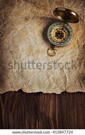 Nautical background with retro compass on old yellowed paper