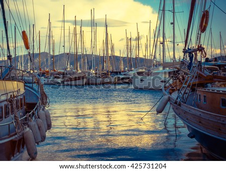 Nautical landscape with boats and yacht at sunset. Yachting and luxury leisure. Travel and sea vacation, sea harbor on Turkey coast. Sea voyage in a summer holidays. - stock photo