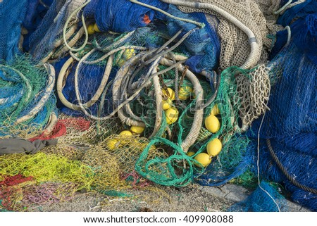 Nautical, rigs and fishing nets with a port in Mallorca, Spain. Detail of wires and cords - stock photo
