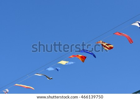 Nautical signal flags flying from a ships rigging